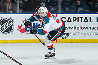 KELOWNA, CANADA - MARCH 13: Schael Higson #21 of the Kelowna Rockets takes a shot against the Spokane Chiefs on March 13, 2019 at Prospera Place in Kelowna, British Columbia, Canada.  (Photo by Marissa Baecker/Shoot the Breeze)