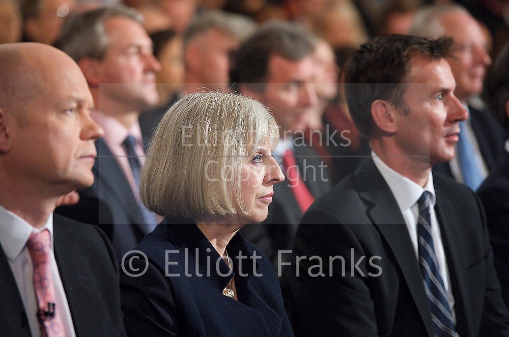 Conservative Party Conference, ICC, Birmingham, Great Britain <br /> 10th October 2012 <br />  Day 4<br /> <br /> Rt Hon David Cameron MP <br /> Prime minister <br /> keynote speech <br /> <br /> William Hague Theresa May Jeremy Hunt watching speech <br /> <br /> Photograph by Elliott Franks<br /> <br /> United Kingdom<br /> Tel 07802 537 220 <br /> elliott@elliottfranks.com<br /> <br /> &copy;2012 Elliott Franks<br /> Agency space rates apply