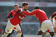 Arsenal striker, Oliver Giroud (12) warming up with Arsenal forward, Joel Campbell (28) during the The FA Cup Quarter Final match between Arsenal and Watford at the Emirates Stadium, London, England on 13 March 2016. Photo by Matthew Redman.