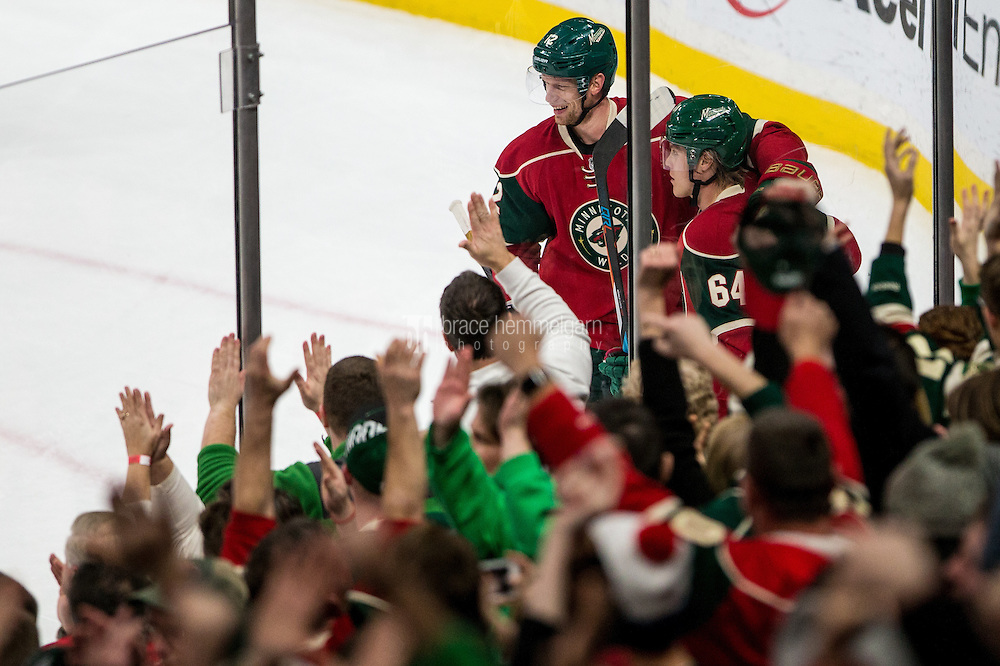 Dec 29, 2016; Saint Paul, MN, USA; Minnesota Wild forward Mikael Granlund (64) celebrates his goal with forward Eric Staal (12) during the third period against the New York Islanders at Xcel Energy Center. The Wild defeated the Islanders 6-4. Mandatory Credit: Brace Hemmelgarn-USA TODAY Sports