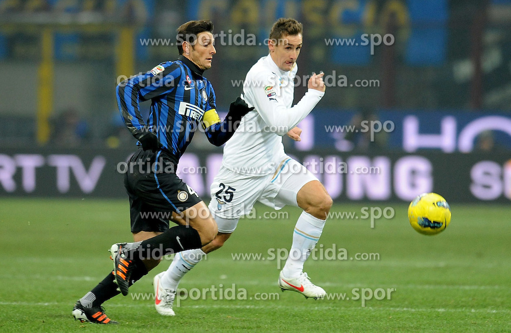 22.01.2012, Stadion Giuseppe Meazza, Mailand, ITA, Serie A, Inter Mailand vs Lazio Rom, 19. Spieltag, im Bild Javier ZANETTI (Inter), Miroslav KLOSE (Lazio), the football match of Italian 'Serie A' league, 19th round, between Inter Mailand and Lazio Rom at Stadium Giuseppe Meazza, Milan, Italy on 2012/01/22. EXPA Pictures © 2012, PhotoCredit: EXPA/ Insidefoto/ Alessandro Sabattini..***** ATTENTION - for AUT, SLO, CRO, SRB, SUI and SWE only *****