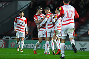 Tommy Rowe of Doncaster Rovers (10) celebrates John Marquis of Doncaster Rovers (9) and with team mates after making the score 2-1 during the EFL Sky Bet League 1 match between Doncaster Rovers and AFC Wimbledon at the Keepmoat Stadium, Doncaster, England on 17 November 2018.