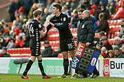 Leeds United midfielder Conor Shaughnessy (35) comes off the bench doe Leeds United midfielder Eunan O'Kane (14) ' during the EFL Sky Bet Championship match between Barnsley and Leeds United at Oakwell, Barnsley, England on 25 November 2017. Photo by Simon Davies.
