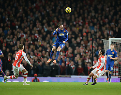 Manchester United's Wayne Rooney leaps to head a high ball. - Photo mandatory by-line: Alex James/JMP - Mobile: 07966 386802 - 22/11/2014 - Sport - Football - London - Emirates Stadium - Arsenal v Manchester United - Barclays Premier League