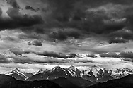 Eiger, Mönch and Jungfrau and rain clouds of a cold front from the Niederhorn, Interlaken, Berne, Switzerland