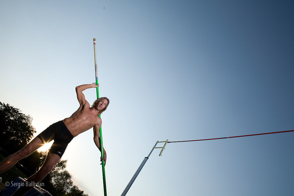 A pole-vaulter in flight at a training in Boulder, CO
