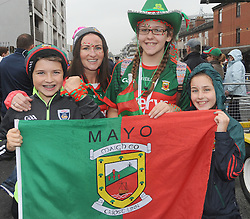 Mayo Fans from Hollymount at Croke Park for the All Ireland final Cathal, Patricia and Orla Maloney with Chloe Jennings <br />