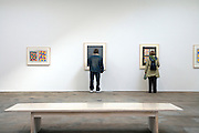 people looking from very close by to art on wall Matthew Marks Gallery Chelsea NY artworks by Jasper Johns