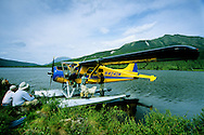 Float plane dropping off passengers at Vet Lake in the Central Brooks Range. North of Bettles, Alaska