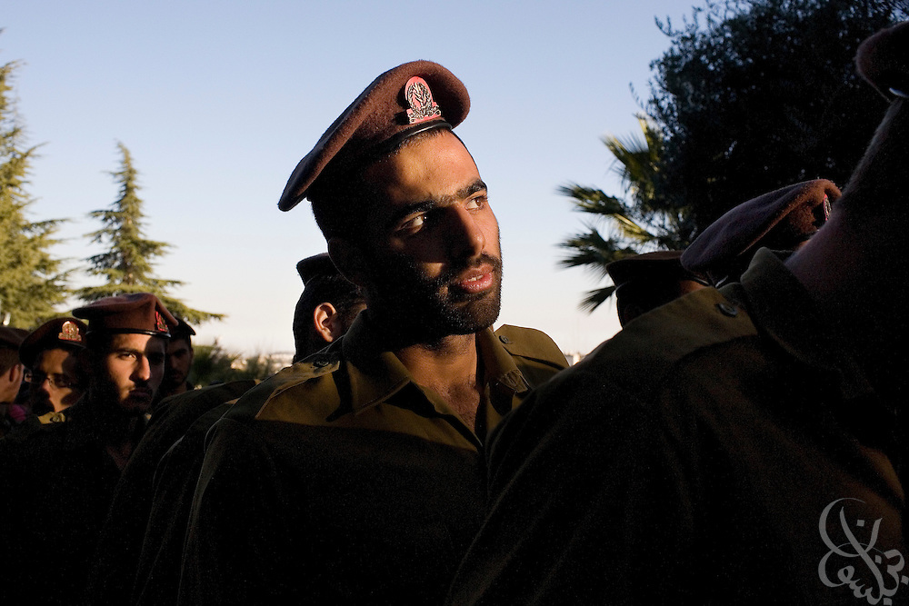 An Israeli soldier color guard readies to lead the funeral of Major Dagan Vertman, 32,  at the Mt. Herzl cemetery in Jerusalem, Tuesday, Jan. 6, 2009. Vertman and two other soldiers were killed Monday night when an  Israeli tank mistakenly fired on their position in an apparent friendly-fire incident according to the Israeli army.