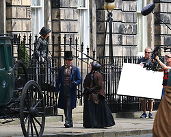"Moray Place in Edinburgh's Georgian old town was turned into 19th century London for Julian Fellowes' new ITV show ""Belgravia"".<br /> <br /> Pictured: Tamsin Greig (striped dress) doing a take<br /> <br /> Alex Todd 