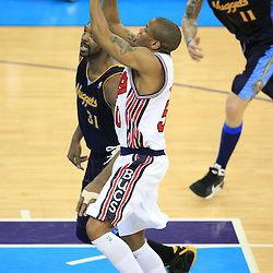 28 January 2009:  New Orleans Hornets guard Antonio Daniels (50) shoots over Denver Nuggets center Nene Hilario (31) during a 94-81 win by the New Orleans Hornets over the Denver Nuggets at the New Orleans Arena in New Orleans, LA. The Hornets wore special throwback uniforms of the former ABA franchise the New Orleans Buccaneers for the game as they honored the Bucs franchise as a part of the NBA's Hardwood Classics series. .