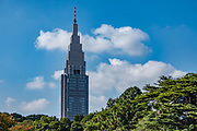 "The NTT Docomo Yoyogi Building rises above Shinjuku Gyoen National Garden, in Shinjuku ward, Tokyo, Japan. At 240 metres (790 ft) tall, this skyscraper is the fourth tallest building in Tokyo. It mainly houses technical and switching equipment for the company's cellular telephone service, plus some offices. Shinjuku Gyoen originated during the Edo Period (1603-1867) as a feudal lord's Tokyo residence. Later it was converted into a botanical garden before being transferred to the Imperial Family in 1903 who used used it for recreation and the entertainment of guests. The park was almost completely destroyed during World War II, but was eventually rebuilt and reopened in 1949 as a public park. Access Shinjuku Gyoen park via three gates: Shinjuku Gate is a ten minute walk east from the ""New South Exit"" of JR Shinjuku Station or a five minute walk from Shinjukugyoenmae Station on the Marunouchi Subway Line. Okido Gate is a five minute walk from Shinjukugyoenmae Station on the Marunouchi Subway Line. Sendagaya Gate is a five minute walk from JR Sendagaya Station on the local Chuo/Sobu Line."