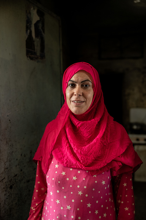 9 August 2018 – Mosul – Iraq – An Iraqi woman is photographed in the doorway of her kitchen inside a damaged home in al-Islah al Zirahee neighborhood of West Mosul. <br /> <br /> This home is amongst the houses due to be rehabilitated with the support of UNDP's Funding Facility for Stabilization (FFS). <br /> <br /> © UNDP Iraq / Claire Thomas