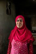 9 August 2018 &ndash; Mosul &ndash; Iraq &ndash; An Iraqi woman is photographed in the doorway of her kitchen inside a damaged home in al-Islah al Zirahee neighborhood of West Mosul. <br /> <br /> This home is amongst the houses due to be rehabilitated with the support of UNDP&rsquo;s Funding Facility for Stabilization (FFS). <br /> <br /> &copy; UNDP Iraq / Claire Thomas