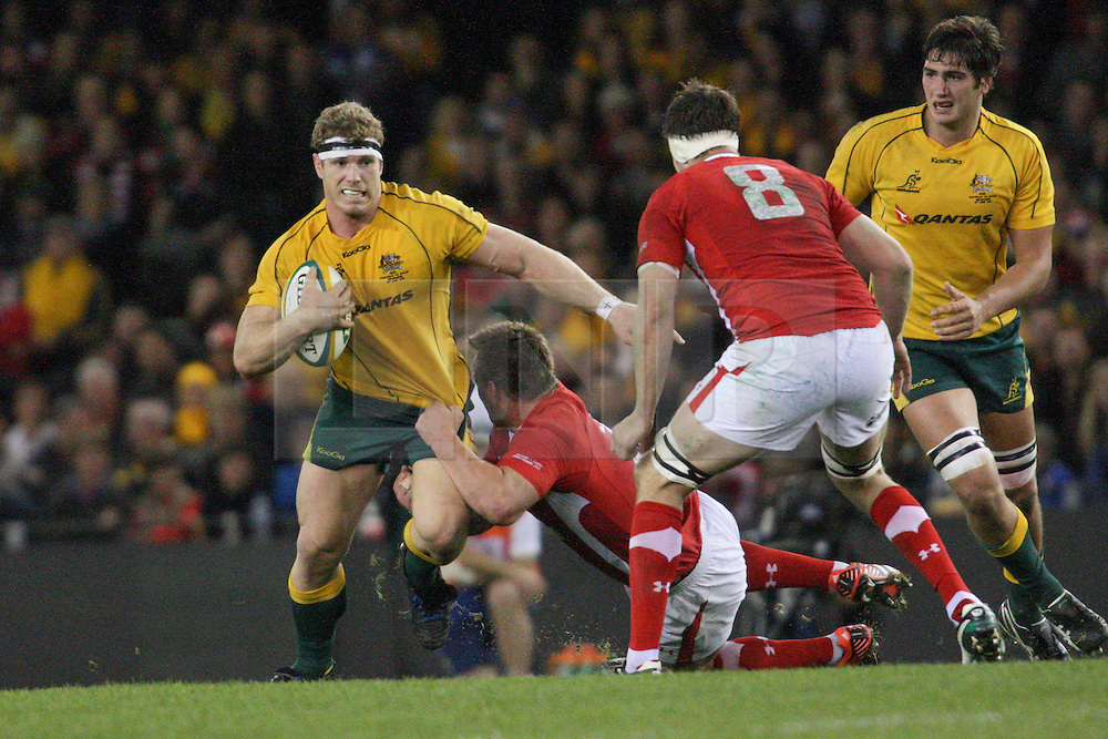 © Licensed to London News Pictures. 16/06/2012. Etihad Stadium, Melbourne Australia. David Pocock gets tackled during the 2nd Rugby Test between Australia Wallabies Vs Wales . Photo credit : Asanka Brendon Ratnayake/LNP