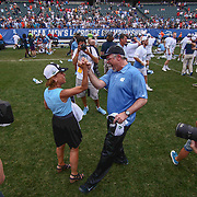 North Carolina Head Coach JOE BRESCHI, right, celebrates with UNC Chancellor CAROL FOLT, left,  after North Carolina defeated Maryland 14-13 in overtime during The NCAA Division I NATIONAL CHAMPIONSHIP GAME between North Carolina and Maryland, Monday, May. 30, 2016 at Lincoln Financial Field in Philadelphia, Pa