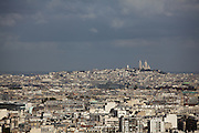 Overlooking Paris across the Seine looking towards The Basilica of the Sacred Heart of Paris, which is commonly known as Sacré-Cœur Basilica. It is a Roman Catholic church and minor basilica, dedicated to the Sacred Heart of Jesus, in Paris, France.