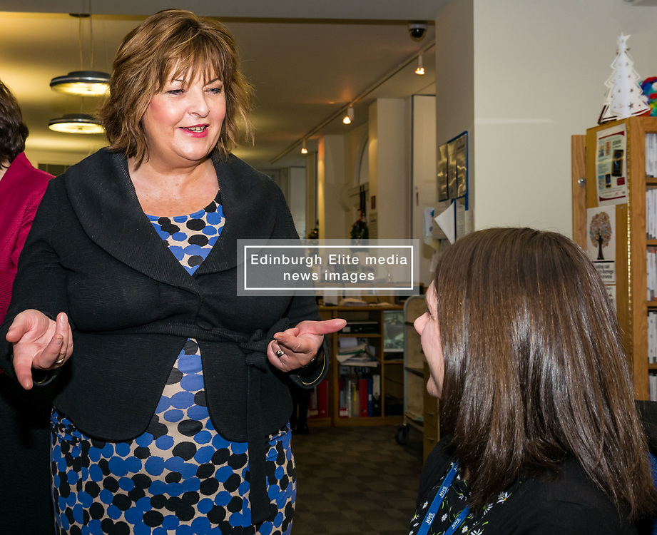 Pictured: Scottish Government Public Libraries Funding Announcement. Culture Minister Fiona Hyslop announces this year's successful bids to the £450,000 Public Library Improvement Fund (PLIF) at the John Grey Centre, Haddington Library, Haddington, East Lothian, Scotland, United Kingdom.  PLIF has been supporting innovative library projects since 2006 which help both individuals and communities. A member of staff demonstrates the use of Boarmaker for children with communication difficulties. 13 December 2018  <br /> <br /> Sally Anderson | EdinburghElitemedia.co.uk