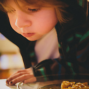 Micah Goodrich reads his Lego Magazine at breakfast before headed to school during the cold of winter in Jackson, Wyoming.