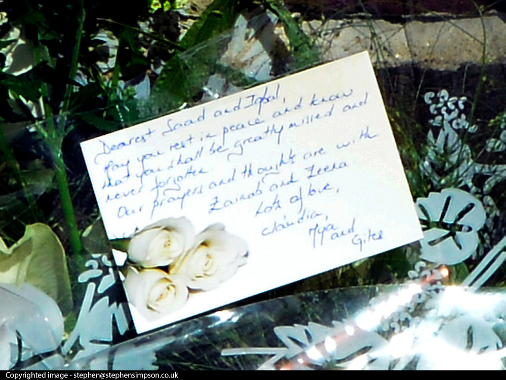 © Licensed to London News Pictures. 07/09/2012. Claygate, UK Cards on flowers left at the scene. People lay flowers at the scene. The family home of Saad al-Hilli in Claygate, near Esher. Three members ofof the family have been shot dead in the French Alps. Photo credit : Stephen Simpson/LNP