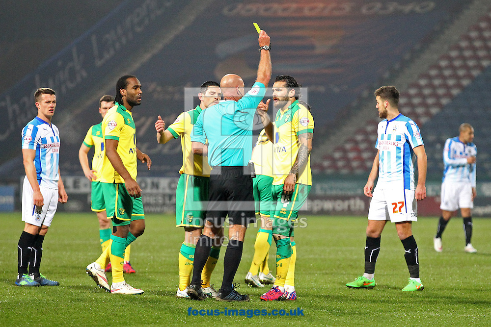Bradley Johnson of Norwich gets a yellow card from Referee Nigel Miller for handball during the Sky Bet Championship match at the John Smiths Stadium, Huddersfield<br /> Picture by Paul Chesterton/Focus Images Ltd +44 7904 640267<br /> 17/03/2015