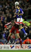 Photo: Paul Thomas.<br /> Liverpool v Cardiff City. Carling Cup. 31/10/2007.<br /> <br /> Rodger Johnson (R) of Cardiff battles for the ball from Peter Crouch.