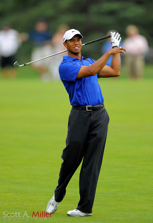 Aug 15, 2009; Chaska, MN, USA; Tiger Woods (USA) drops his club as he reacts to his shot from the 5th fairway during the third round of the 2009 PGA Championship at Hazeltine National Golf Club.  ©2009 Scott A. Miller