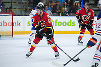 PENTICTON, CANADA - SEPTEMBER 17: Dillon Dube #59 of Calgary Flames looks to block a shot by the Edmonton Oilers on September 17, 2016 at the South Okanagan Event Centre in Penticton, British Columbia, Canada.  (Photo by Marissa Baecker/Shoot the Breeze)  *** Local Caption *** Dillon Dube;