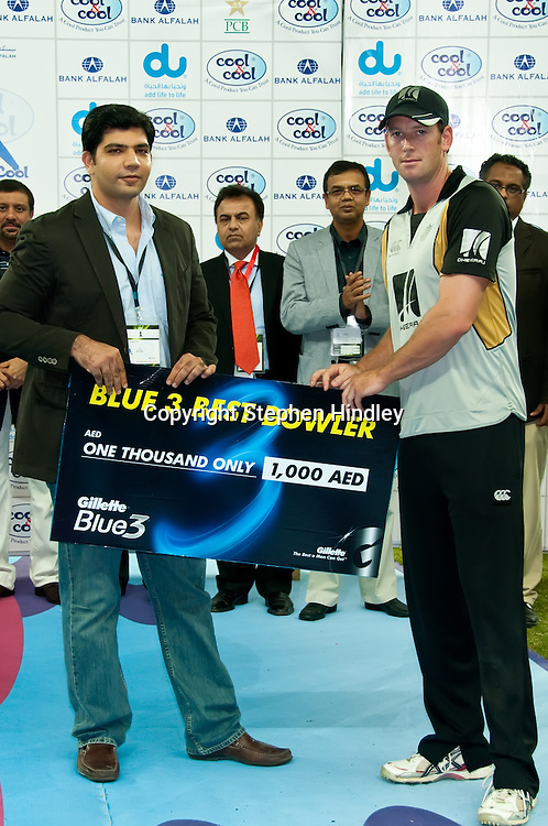 "Dubai, UAE.  Ian Butler wins the ""Best Bowler"" prize after the 2nd T20 (Twenty20) match between Pakistan and New Zealand held at Dubai International Cricket Stadium on the 13th November, 2009.  Photo by: Stephen Hindley/SPORTDXB/PHOTOSPORT"