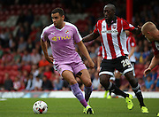Hal Robson-Kanu (Robson Kanu) (Reading midfielder) holding off the advances of Toumani Diagouraga (Brentford midfielder)  during the Sky Bet Championship match between Brentford and Reading at Griffin Park, London, England on 29 August 2015. Photo by Matthew Redman.