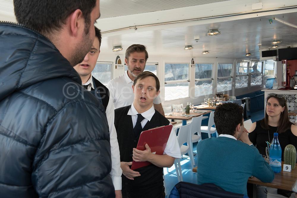 Davide receiving customers