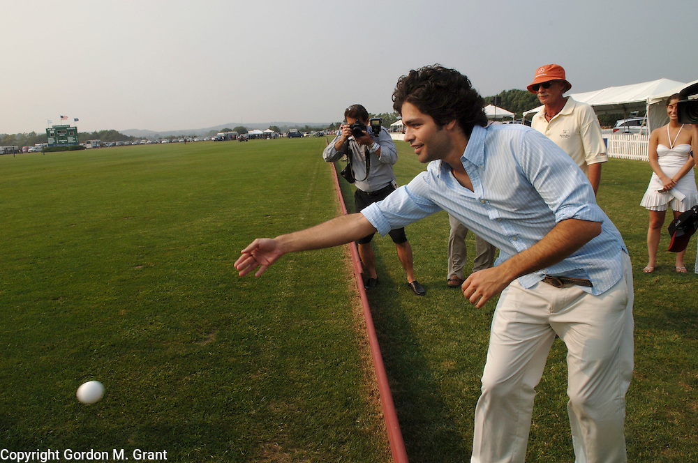 Bridgehampton, NY - 8/13/05 - Actor Adrian Grenier of the HBO show &quot;Entourage&quot; throws out the first ball at the start of The Mercedes Benz Polo Challenge at The Bridgehampton Polo Club in Bridgehampton, NY August 13, 2005.     (Photo by Gordon M. Grant / Zuma Press)<br />