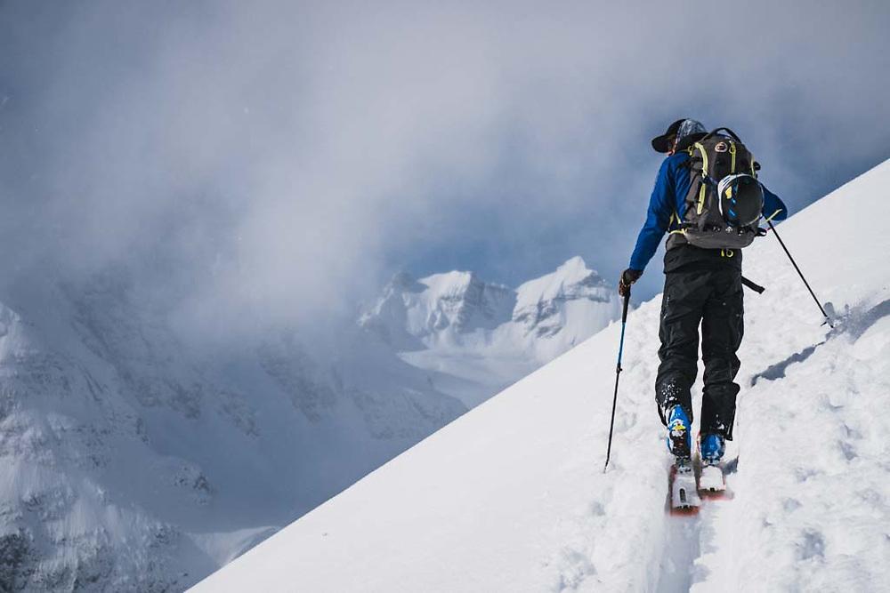 Simon Thomson on his way up to Solitaire Ski Peak, Howson Range, British Columbia.