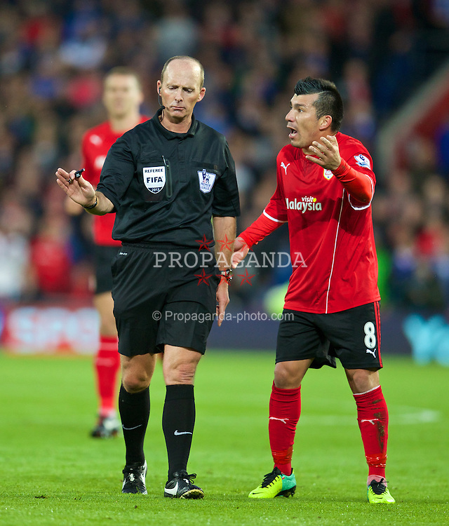 CARDIFF, WALES - Sunday, November 3, 2013: Cardiff City's Gary Medel complains to referee Mike Dean during the Premiership match against Swansea City at the Cardiff City Stadium. (Pic by David Rawcliffe/Propaganda)