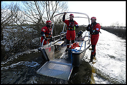 A rescue boat on the Somerset Levels . The Somerset Levels are Flooded due to heavy rain in January. London, United Kingdom. Tuesday, 4th February 2014. Picture by Andrew Parsons / i-Images