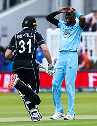 Jofra Archer of England cuts a frustrated figure as Martin Guptill of New Zealand runs past - Mandatory by-line: Robbie Stephenson/JMP - 14/07/2019 - CRICKET - Lords - London, England - England v New Zealand - ICC Cricket World Cup 2019 - Final