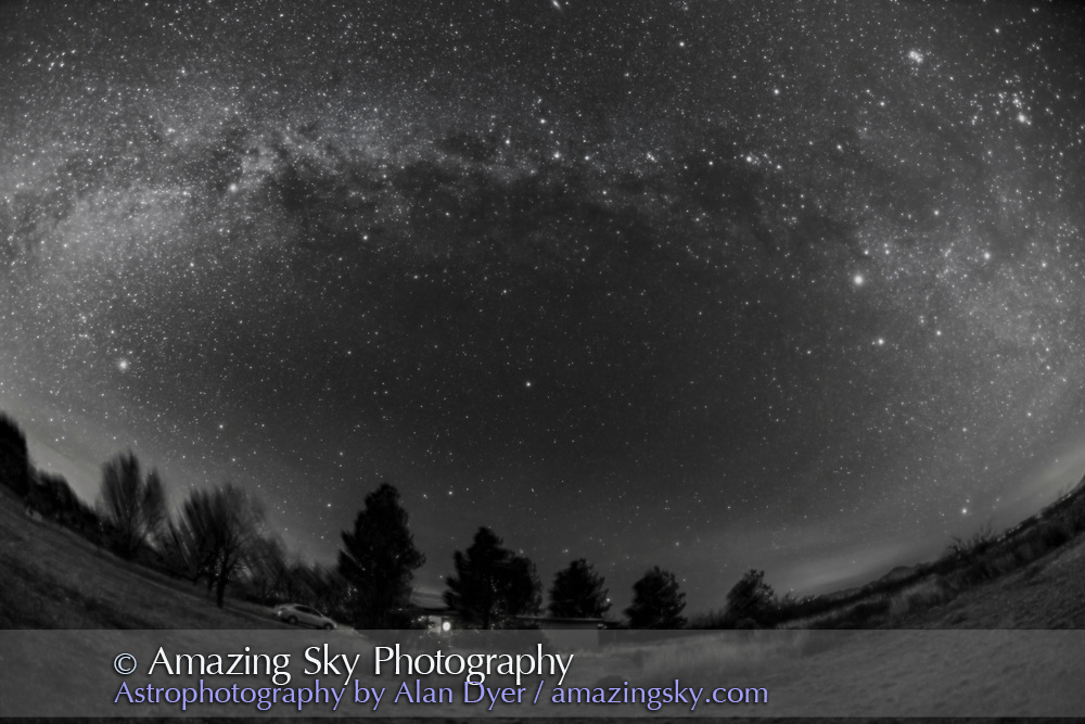 The autumn Milky Way over the Quailway Cottage near Portal, Arizona, on a slightly hazy December evening, adding the star glows. We are looking due north here with Polaris just below centre. Cassiopeia is overhead at top. Cygnus is at left in the west; Auriga is at right in the east. This is with the 15mm full-frame fish-eye lens, and so takes in a wide 180&deg; view of the sky, and from horizon to zenith. <br /> <br /> This is a stack of 4 x 3-minute exposures for the sky at f/4 and ISO 1600, with the camera tracking the sky, and 2 x 3-minute exposures for the ground at f/2.8 and ISO 1600 but with the camera not tracking, to avoid blurring the ground. There is some blurring in the trees, which I think looks fine. The tracker was the iOptron Sky-Tracker, the camera the Canon 6D. This version of the image has been processed to make the view better resemble what you see with the unaided eye, in a largely monochrome and softer view than the colourful and high-contrast views commonly presented in astrophotos. Even at that there is more fine structure present in the Milky Way than the unaided eye usually sees, though binoculars beging to reveal that smaller detail. I have left some colours in some stars and in the foreground of landscape scenes.