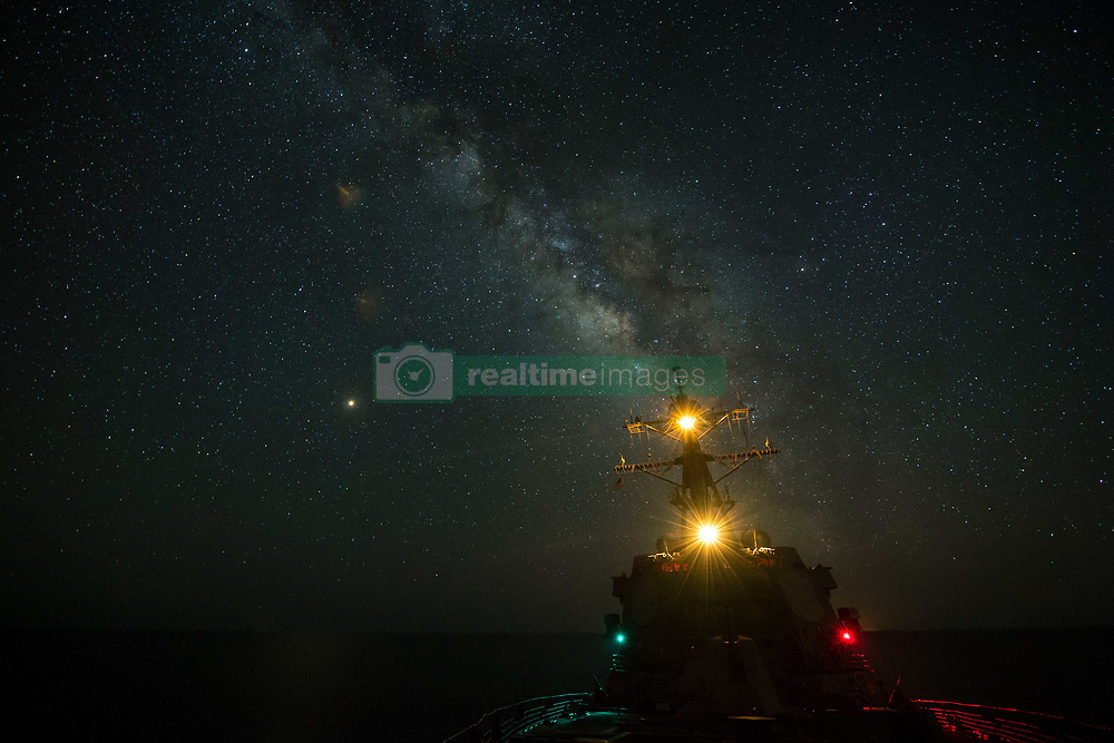 RED SEA (Aug. 1, 2018) The guided-missile destroyer USS Jason Dunham (DDG 109) transits the Red Sea at night during exercise Eagle Salute 18. Eagle Salute 18 is a surface exercise with the Egyptian Naval Force (ENF) conducted to enhance interoperability and war-fighting readiness, fortify military-to-military relationships and advance operational capabilities of all participating units. Jason Dunham is deployed to the U.S. 5th Fleet area of operations in support of naval operations to ensure maritime stability and security in the Central region, connecting the Mediterranean and the Pacific through the western Indian Ocean and three strategic choke points. (U.S. Navy photo by Senior Chief Intelligence Specialist Matt Bodenner/Released) 180801-N-PY230-4224