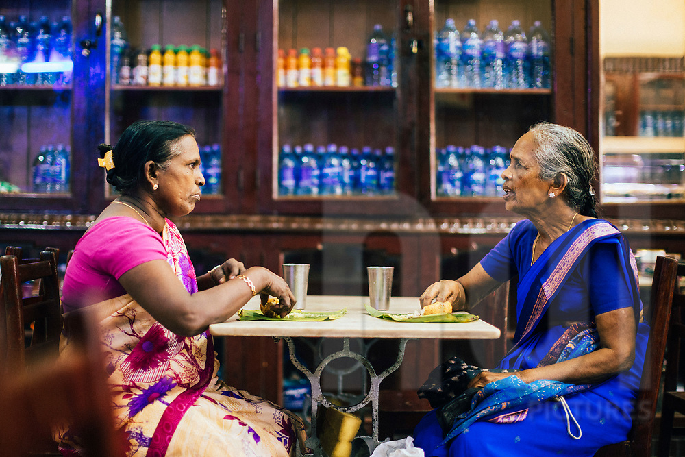 Two women eating lunch at a small cafe, Jaffna, Sri Lanka, Asia