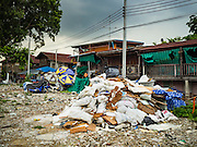 20 SEPTEMBER 2016 - BANGKOK, THAILAND:  One year after 54 families were forcibly evicted the grounds around Wat Kalayanamit are still undeveloped. Fifty-four homes around Wat Kalayanamit, a historic Buddhist temple on the Chao Phraya River in the Thonburi section of Bangkok, were razed and the residents evicted to make way for new development at the temple. The abbot of the temple said he evicted the residents, who lived on the temple grounds for generations, because their homes were unsafe and because he wants to improve the temple grounds. The evictions are a part of a Bangkok trend, especially along the Chao Phraya River and BTS light rail lines. Low income people are being evicted from their long time homes to make way for urban renewal.           PHOTO BY JACK KURTZ