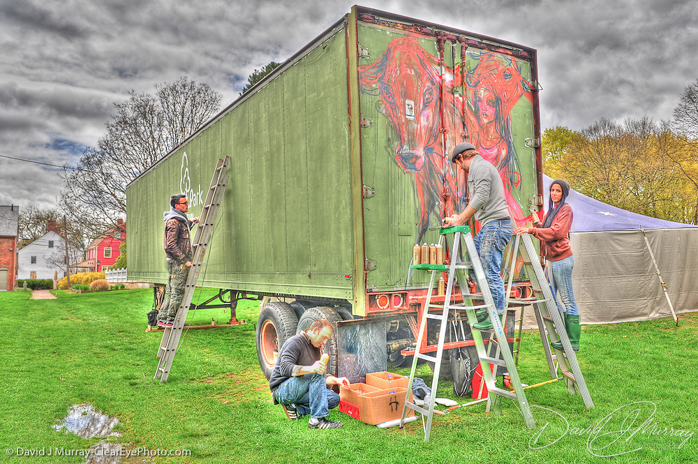 """Artists working on street art pieces in Prescott Park, Portsmouth, NH as part of the """"Street a.k.a. museum"""" show at the Portsmouth Museum of Art. Left to right: Andreas von Chrzanowski (""""Case""""), Andy Ritzo, Akut and Hera, who together make up the artist duo Herakut."""