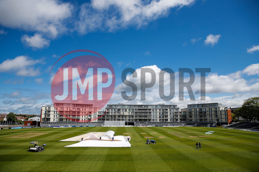 General View as groundsmen work to remove the covers as the sun breaks through after play is delayed on the first morning due to rain - Photo mandatory by-line: Rogan Thomson/JMP - 07966 386802 - 18/05/2015 - SPORT - CRICKET - Bristol, England - Bristol County Ground - Gloucestershire v Kent - Day 1 - LV= County Championship Division Two.