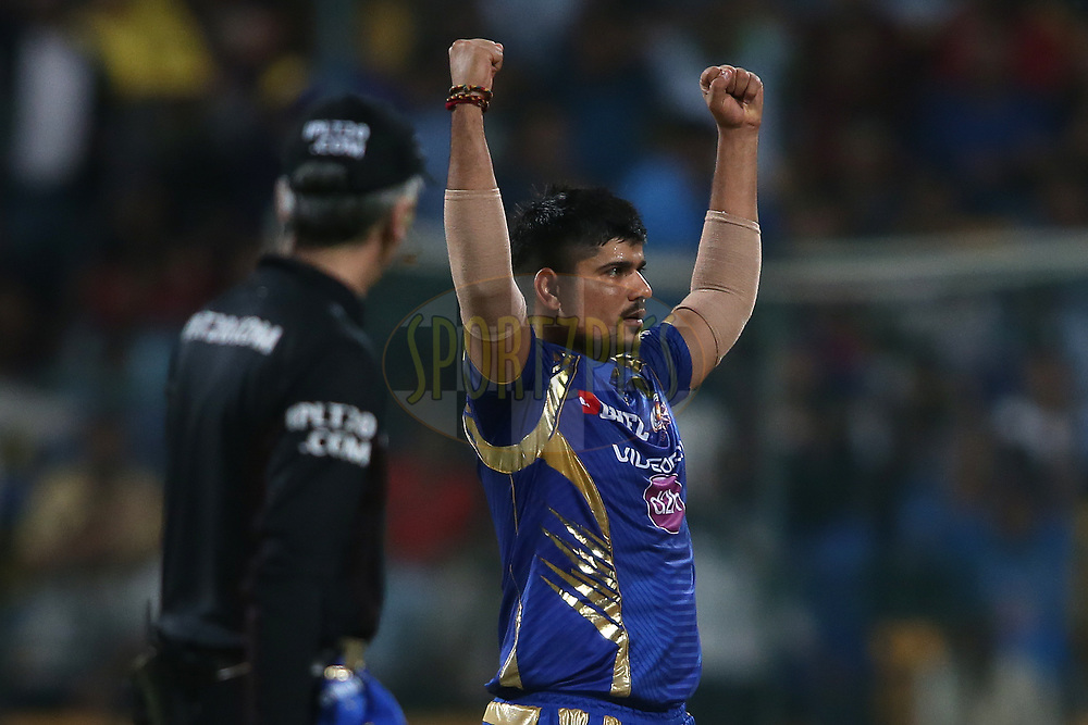 Karn Sharma of the Mumbai Indians celebrates getting Ishank Jaggi of the Kolkata Knight Riders wicket during the 2nd qualifier match of the Vivo 2017 Indian Premier League between the Mumbai Indians and the Kolkata Knight Riders held at the M.Chinnaswamy Stadium in Bangalore, India on the 19th May 2017<br /> <br /> Photo by Shaun Roy - Sportzpics - IPL
