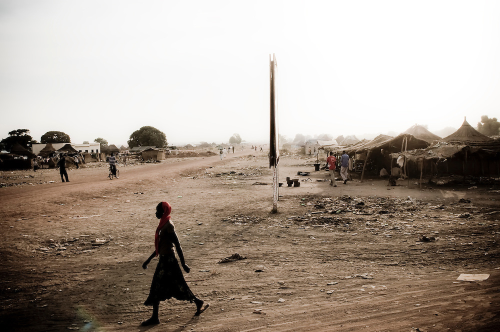 Pictured is a street scene in the Southern Sudanese town of Aweil. Sudan recently voted on whether or not to remain with the North or to set out alone as the world's newest nation. (© William B. Plowman)
