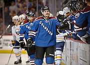 SHOT 3/28/15 7:25:40 PM - The Colorado Avalanche's John Mitchell #7 celebrates after scoring a goal against the Buffalo Sabres during their regular season NHL game at the Pepsi Center in Denver, Co. The Avalanche won the game 5-3. (Photo by Marc Piscotty / © 2015)