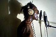 2Double (day dooblay), a 21-year old rap kreyol artist, records a track in the Koze Kreyol studio in Port-au-Prince, Haiti. The rapper has seen some recent success and local recognition, but continues to live in the notorious Cite Soleil slum with his mother and 3-year-old son. He says he hopes to use his music to get his family into a better environment.