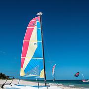 A recreational catamaran Hobie Cat sits on the beach at at Playa Mujeres, north of Cancun, Quintana Roo, Mexico