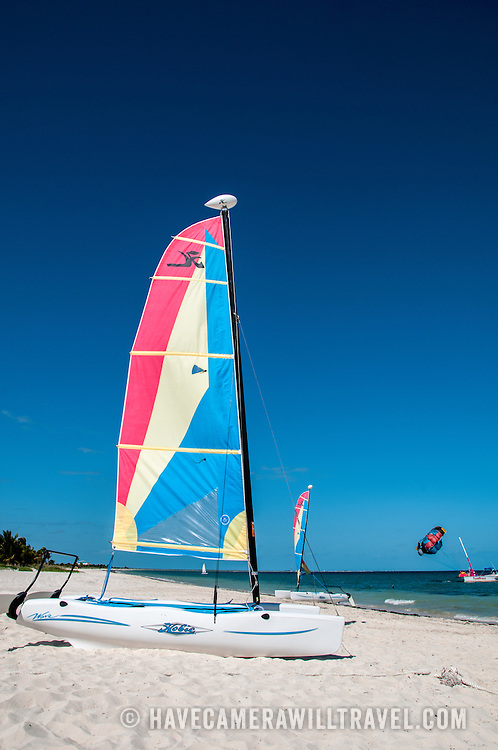 A recreational catamaran Hobie Cat sits on the beach at at Playa Mujeres, north of Cancun, Quintana Roo, Mexico