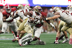 Florida State Seminoles quarterback Deondre Francois (12) rolls out to pass against the Alabama Crimson Tide during the Chick-fil-A Kickoff NCAA football game on Saturday, September 2, 2017, in Atlanta. (Paul Abell via Abell Images for Chick-fil-A Kickoff Game)